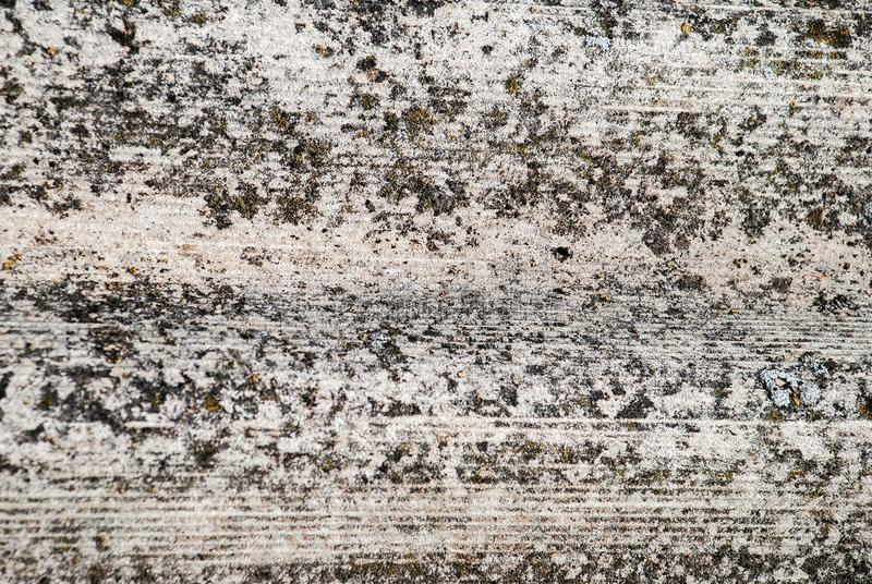 Rough stone wall with cracks of grey.  stock images