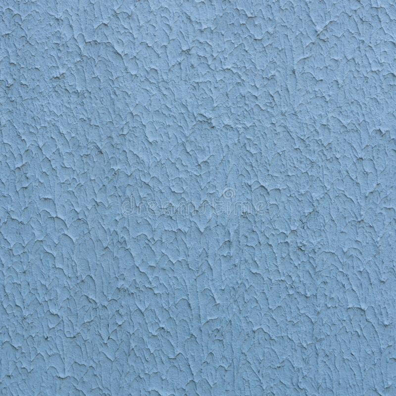 Rough stucco textured background of a wall with natural light. Abstract texture of plaster. stock photography
