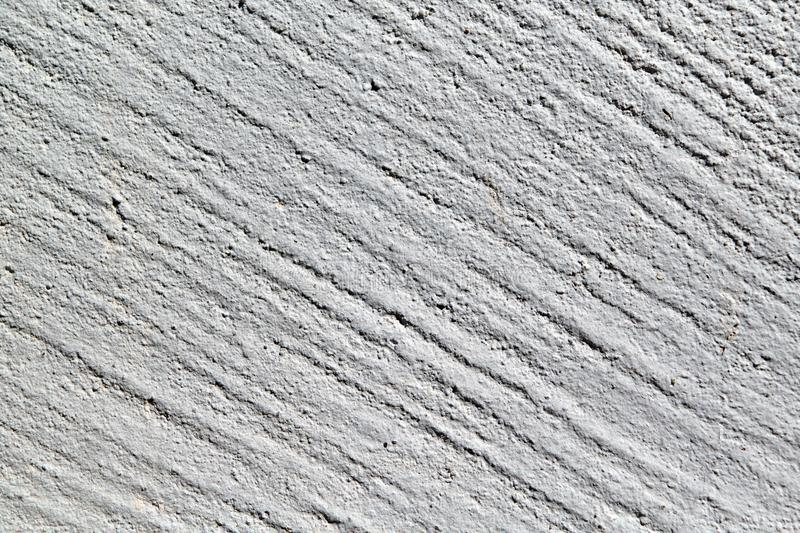 Rough surface of concrete wall with diagonal strips. stock photo