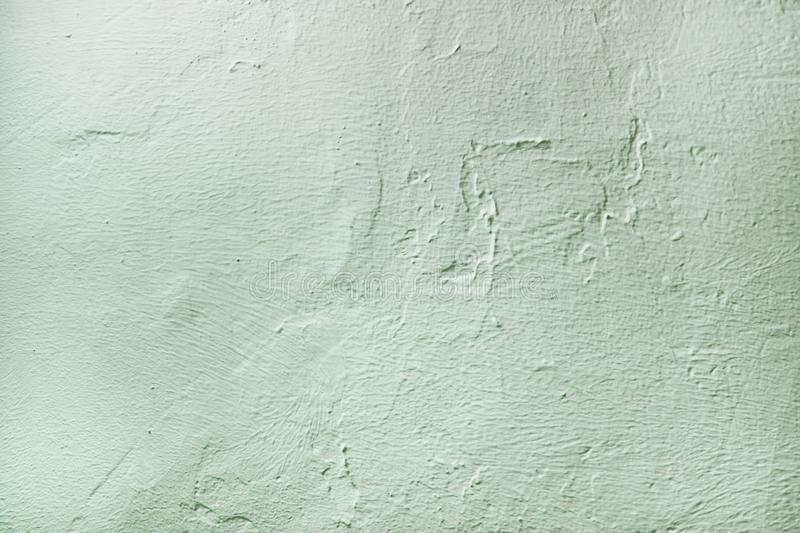 Rough surface plaster texture. Mint pastel light blue color background with copy space. Decorative plastering textured royalty free stock photo