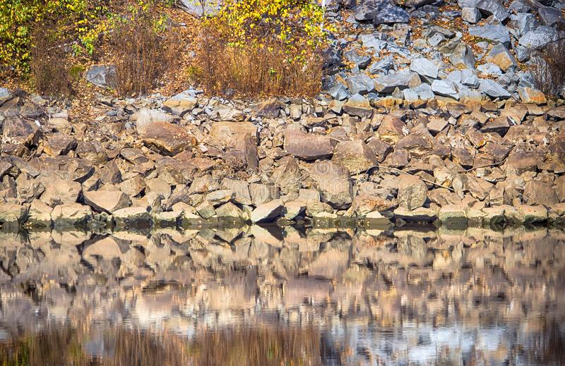 Rough texture of rock, Sandstone reflection water. stock photography
