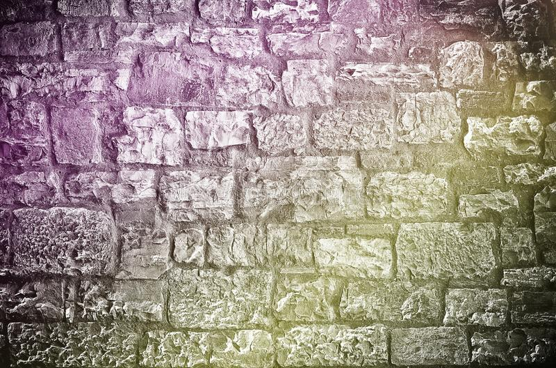 Limestone brick wall. Rough textured limestone brick wall background stock images