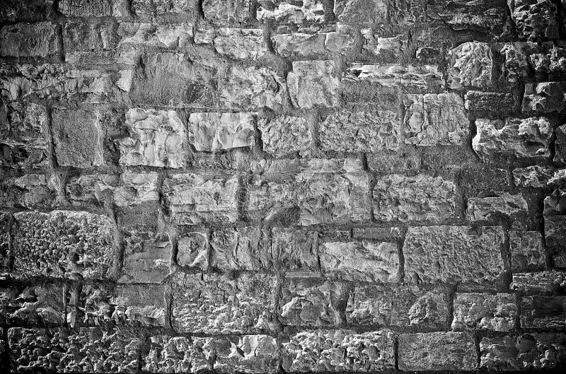 Limestone brick wall. Rough textured limestone brick wall black background stock photos