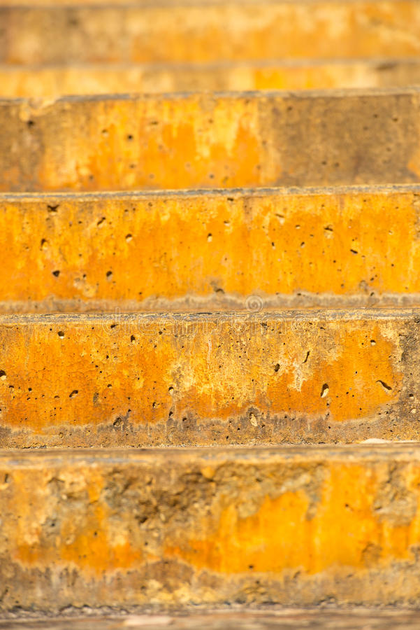 Rough textured outdoor stairs backdrop. Close up rustic orange colored limestone or concrete steps outdoor with abstract pattern and texture, copy space royalty free stock photo