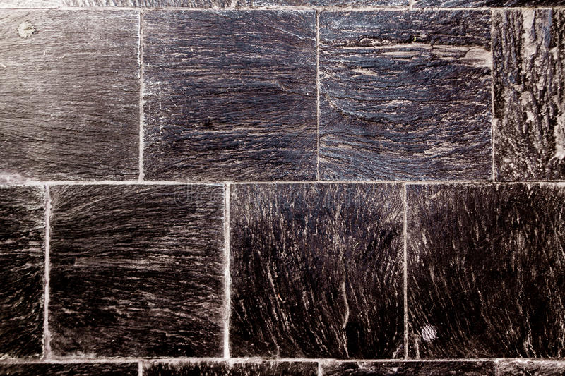 Rough tile floor with black slate stock photography