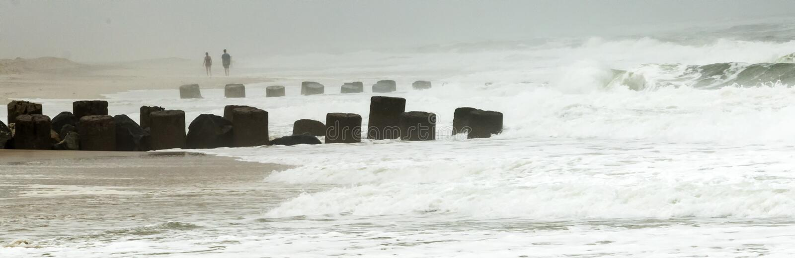 Rough water breaks over a jetty during a storm royalty free stock photo