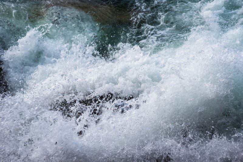 Storm surge waves crashing against shoreline. Rough waves crashing against shoreline royalty free stock photography