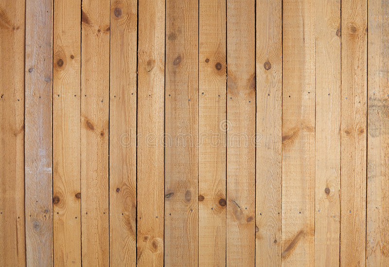 Rough wooden wall. The surface of yellow rough wooden wall royalty free stock photo