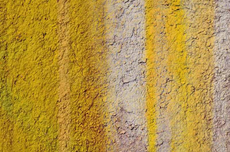 Rough yelllow wall. Rough bumpy plastered wall airbrushed with yellow and white paint stock photography