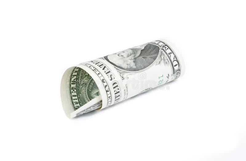 Roulé vers le haut du dollar sur le fond blanc photographie stock libre de droits