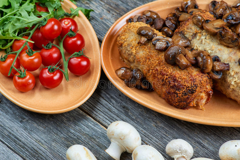 Roulade of pork with roasted mushrooms and potatoes stock image