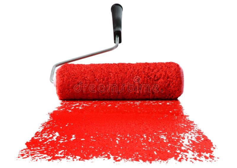 Rouleau avec la peinture rouge photos stock