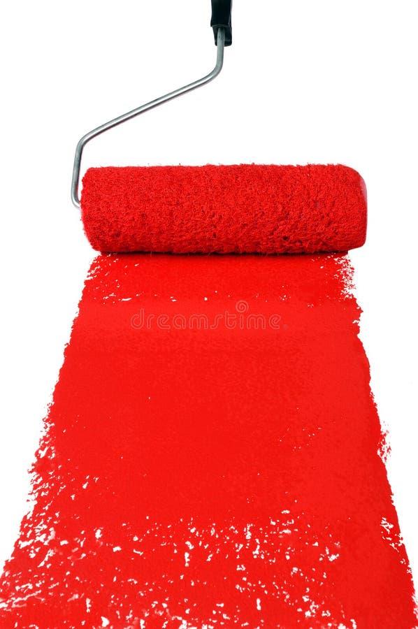 Rouleau avec la peinture rouge photo stock