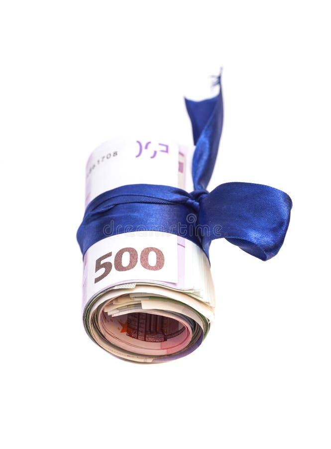 Rouleau d'euro argent et d'arc bleu photographie stock