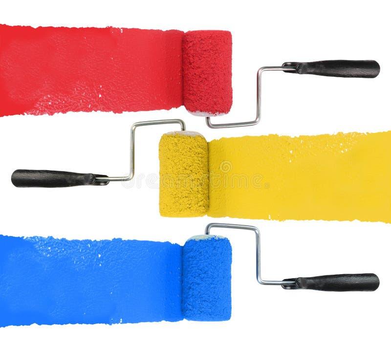 Rouleau de peinture avec rouge et bleu jaunes photo libre de droits