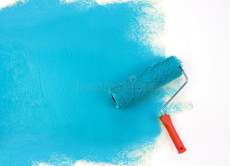 Rouleau de peinture bleu photographie stock