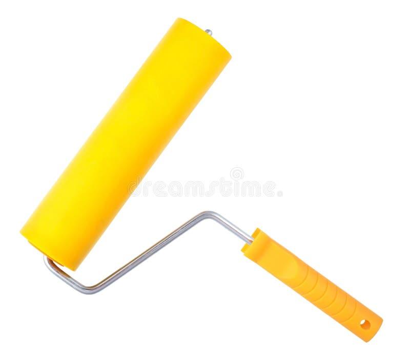 Rouleau de peinture jaune, d'isolement sur le fond blanc image libre de droits