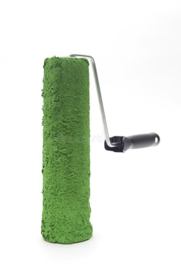 Rouleau de peinture vert photo stock