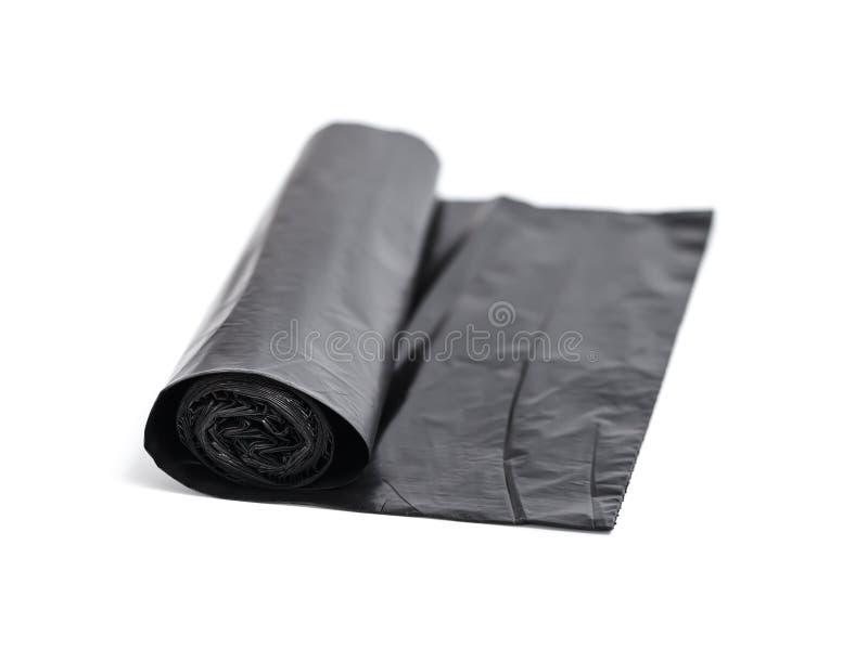 Rouleau de sacs de déchets noirs image stock