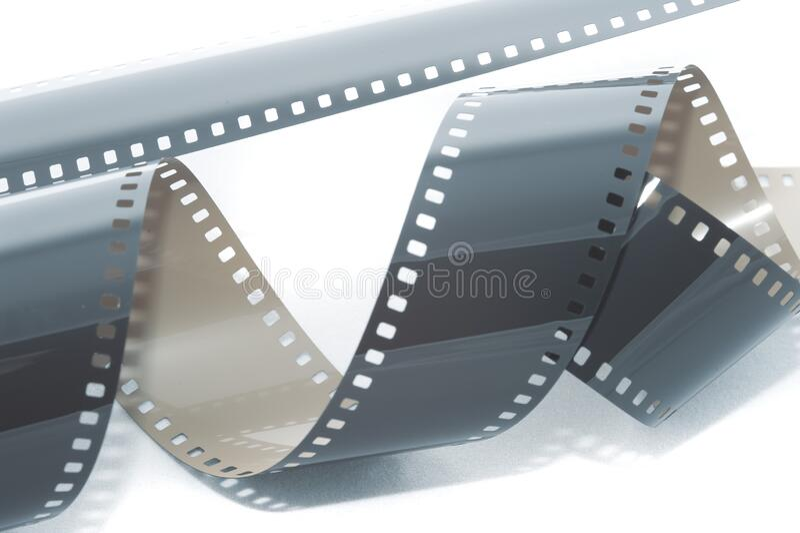 Rouleaux enroulés de pellicule de 35 mm exposée photos libres de droits