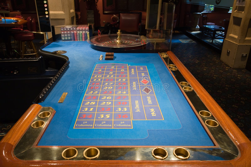 Roulette table in the casino royalty free stock images