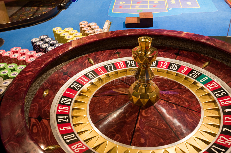 Roulette table in the casino stock image
