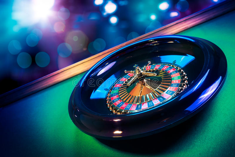 Roulette wheel with a bright and colorful background royalty free stock photography