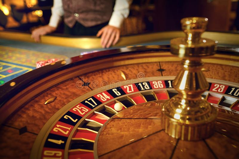 Roulette wheel and croupier hand no table in casino. Roulette betting poker. Gambling in a casino stock images