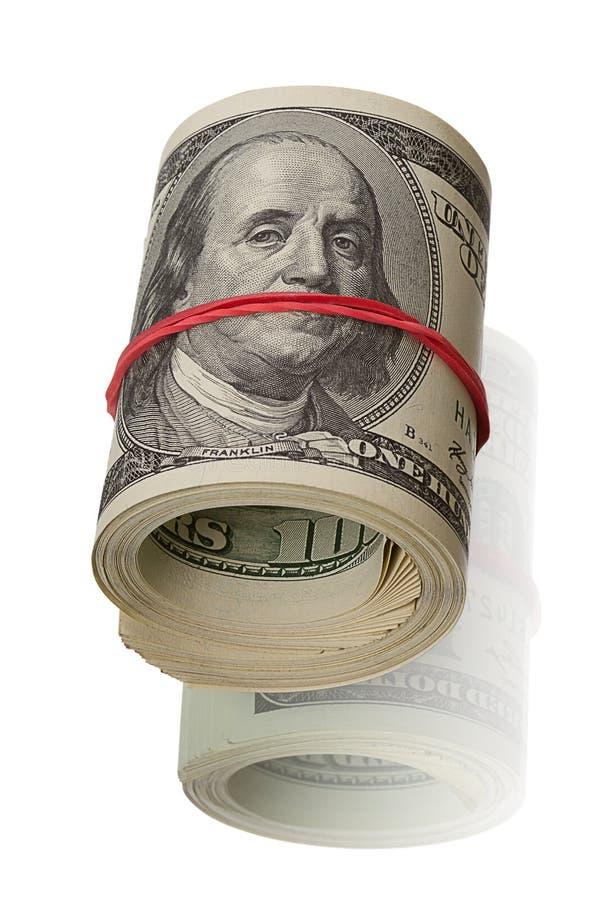 Roulis du dollar sur le blanc photos stock