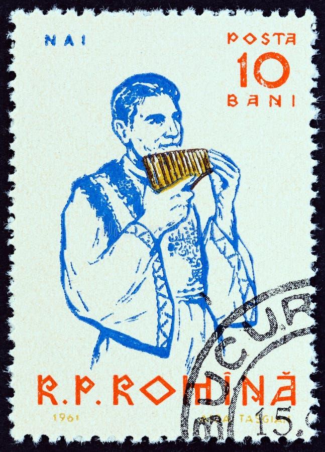ROUMANIE - CIRCA 1961 : Un timbre imprimé en Roumanie montre Pan flûte player, vers 1961 images libres de droits