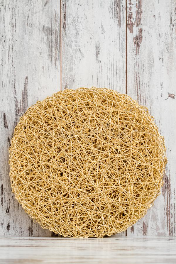 Round American style Yellow, Golden Table Mat on White Background. Round American style yellow, golden table mat on white wooden background stock photography