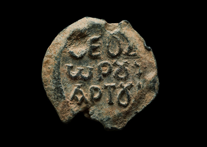 Round antique post seal with greek letters on it royalty free stock photography