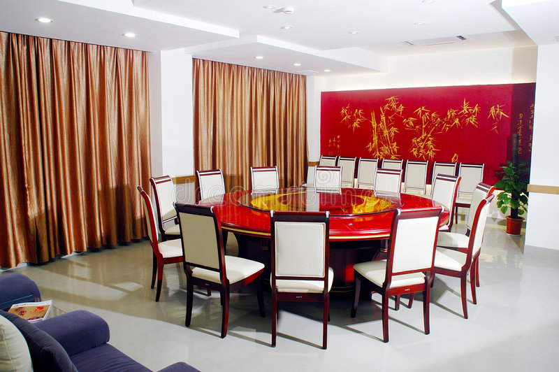 Round banquet table. With chairs by door stock images