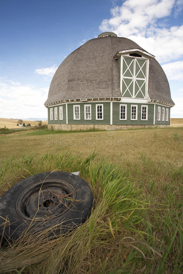 Download Round Barn And Tire In Foreground. Stock Image - Image: 16256671