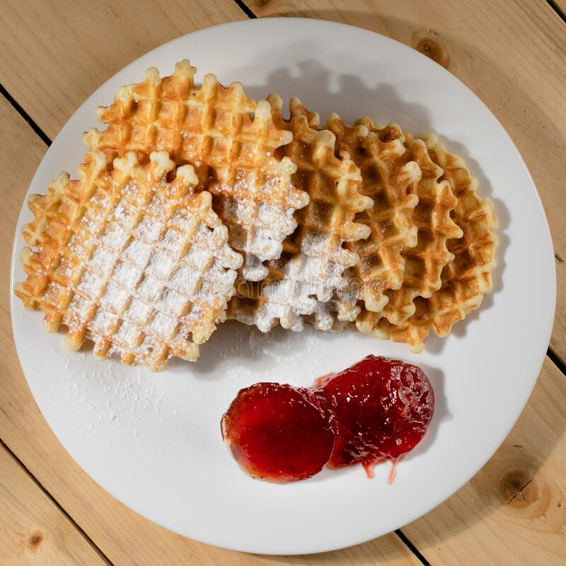 Round belgian waffles on plate royalty free stock images