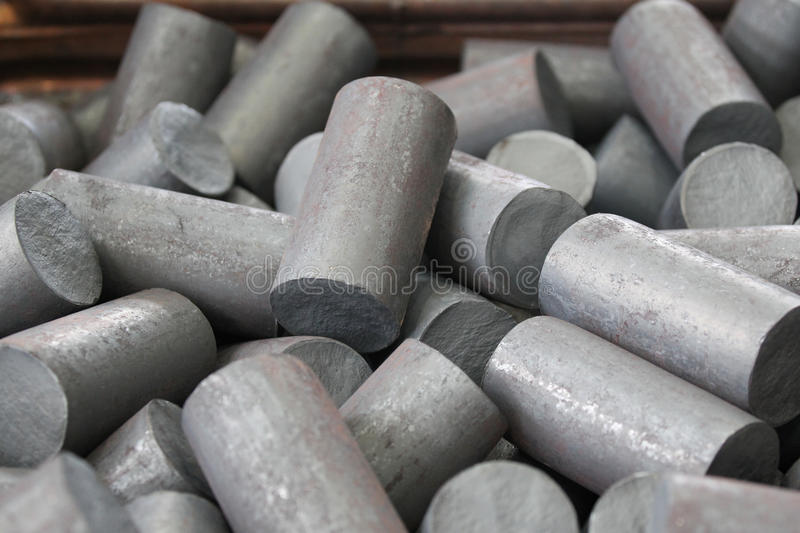 Round billet of metal. Raw materials for further processing stock images