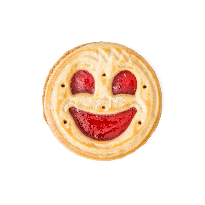 Round biscuit smiling face on the white background, humorous sweet food stock photography