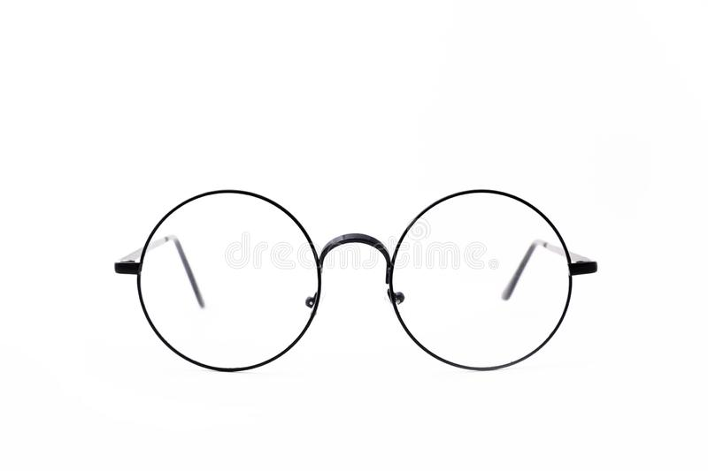 Round black-rimmed glasses are located frontally on a white background. Isolated stock image
