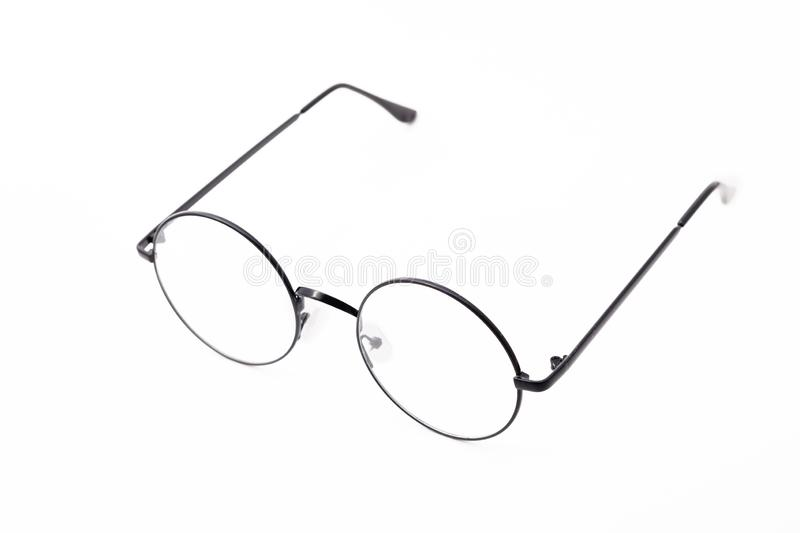 Round black-rimmed glasses are view from above. Isolated on a light background. side view royalty free stock photos
