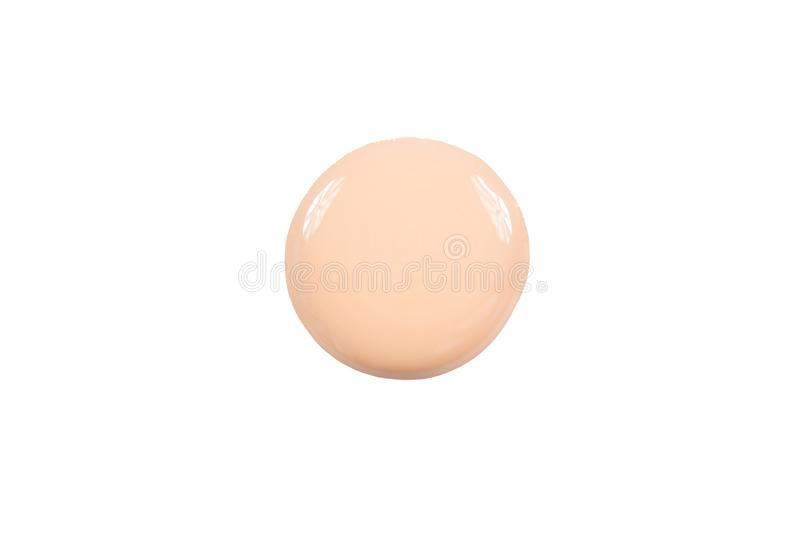 Round blot of liquid foundation smudges isolated on white background.  royalty free stock images
