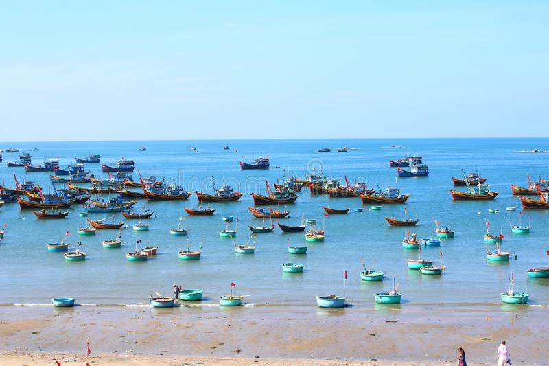 Round blue fishing boats in the open-air Bay. Round blue fishing boats in the sea Bay in the open air waiting for a new exit to the open sea, the sea of colors royalty free stock photo
