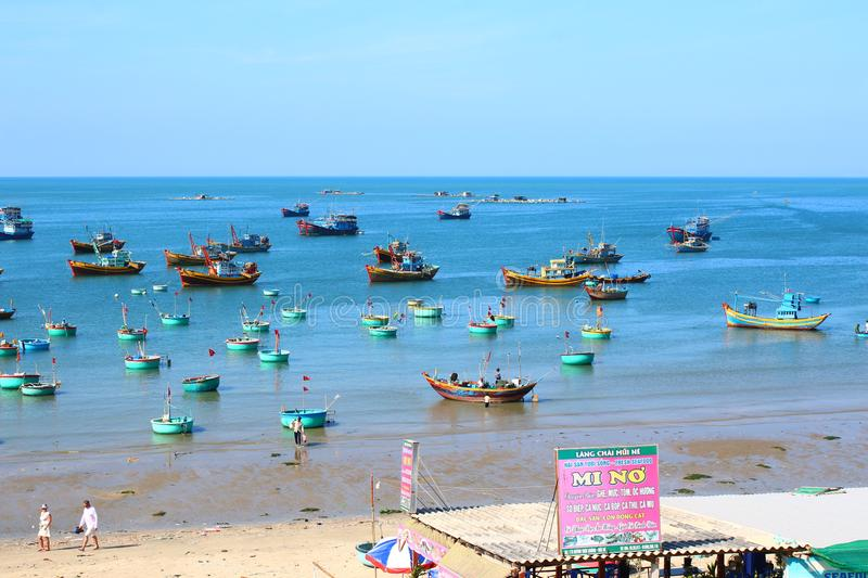 Round blue fishing boats in the open-air Bay. Round blue fishing boats in the sea Bay in the open air waiting for a new exit to the open sea, the sea of colors stock photo