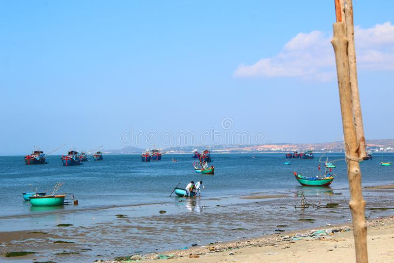 Round blue fishing boats in the open-air Bay royalty free stock images