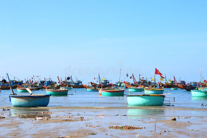 Round blue fishing boats in the open-air Bay stock image