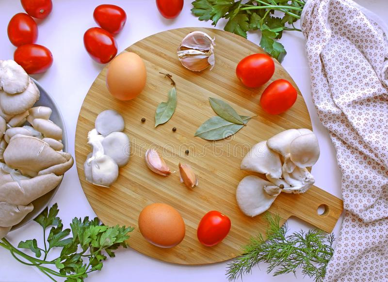 round board with eggs, mushrooms, greens and pepper stock photo