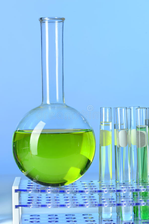 Round Bottom Flask and Test Tubes. Round Bottom Flask with test tubes on racks stock photography