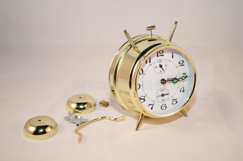 Round Brass and White Bell Alarm Clock royalty free stock images