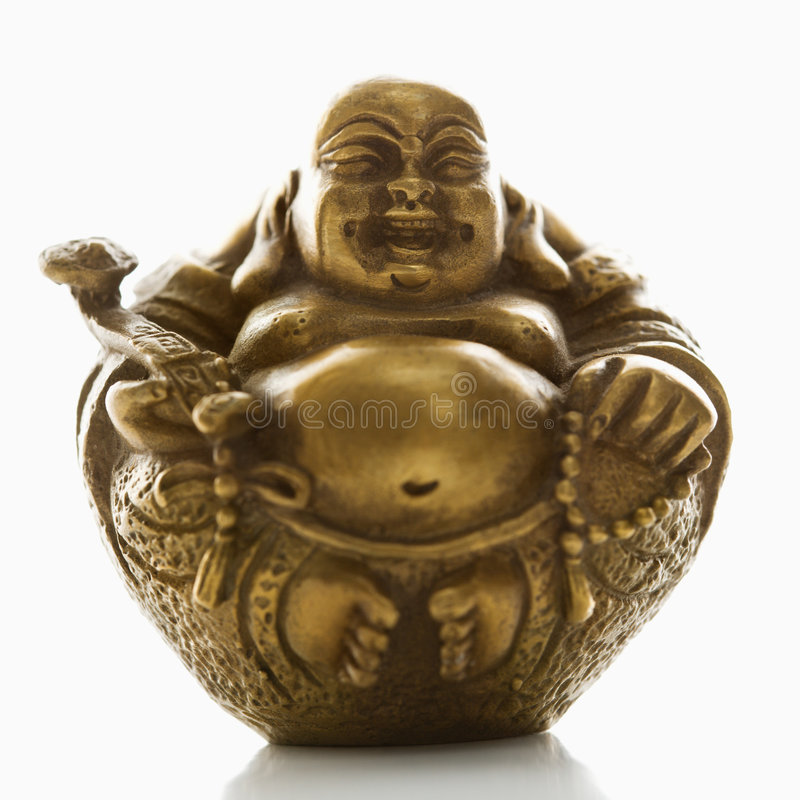 Round Buddha. Happy laughing Buddha brass figurine on white background stock image