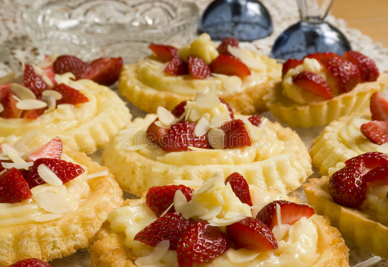 Round cake with fresh strawberries. Home made round cake with fresh strawberries stock image