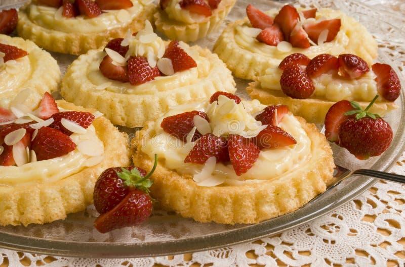 Round cake with fresh strawberries. Home made round cake with fresh strawberries royalty free stock image